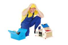 Worker. Man repair broken house Royalty Free Stock Photos