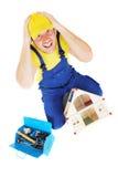 Worker. Man repair broken house Stock Photos