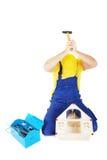Worker. Man repair broken house Stock Images