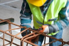 Worker on the construction site royalty free stock image