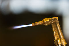 Worker adjust acetylene torch Stock Photography