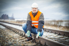 Worker with adjustable wrench on the railroad Stock Photography