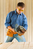 Worker adjusting detail sander Royalty Free Stock Photos