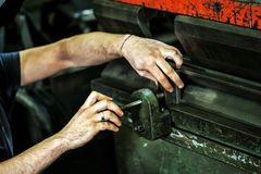 Worker adjusting an industrial machine Royalty Free Stock Photo
