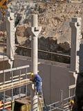 Worker adjusts floor reinforcement. Worker adjust floor reinforcement in underground garage Royalty Free Stock Photo