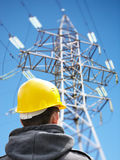 Worker against power lines Royalty Free Stock Image