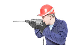 Worker aims drill Stock Images