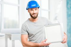 Worker with air filter Royalty Free Stock Photography