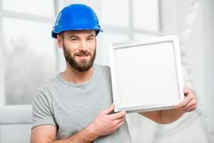 Worker with air filter Royalty Free Stock Images