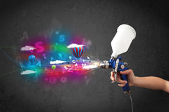 Worker with airbrush and colorful abstract clouds and balloons Royalty Free Stock Photos