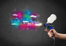 Worker with airbrush and colorful abstract clouds and balloons Stock Photography