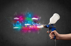 Worker with airbrush and colorful abstract clouds and balloons Royalty Free Stock Images