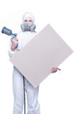 Worker with airbrush gun and blank Royalty Free Stock Photos