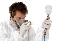Worker with airbrush gun Stock Image