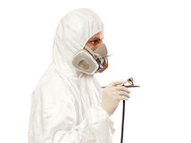 Worker with airbrush gun Royalty Free Stock Image