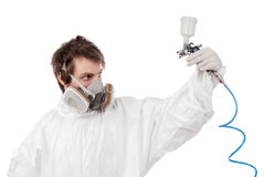 Worker with airbrush gun Royalty Free Stock Images