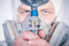 Worker with airbrush gun, selective focus Royalty Free Stock Image