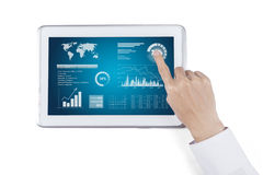 Worker Analyzing Financial Data with Touchpad Royalty Free Stock Photography