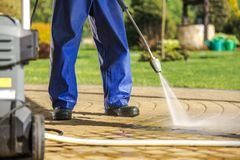 Free Worker And Pressure Washer Stock Image - 151978951