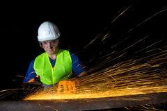Worker with angle grinder Royalty Free Stock Image
