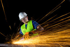 Worker with angle grinder Stock Images