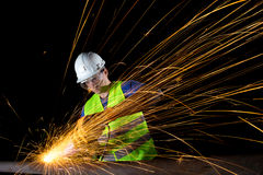 Worker with angle grinder Stock Photos