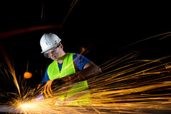 Worker with angle grinder Royalty Free Stock Images