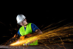 Worker with angle grinder Royalty Free Stock Photo