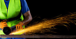 Worker with angle grinder Stock Photo