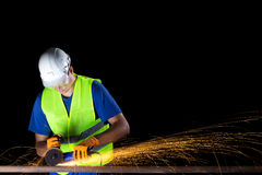 Worker with angle grinder Stock Image
