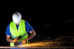 Worker with angle grinder Stock Photography