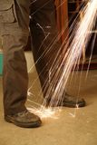 Worker with angle grinder only feet Royalty Free Stock Photos