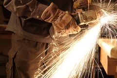 Worker with angle grinder only Hands. And sparks Royalty Free Stock Photography