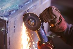 Worker with angle grinder. Sparks from welding or from a torch for metal Royalty Free Stock Image