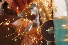 Worker with angle grinder. Sparks from welding or from a torch for metal Stock Photos