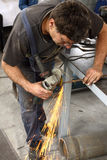 Worker with angle grinder. A worker working with Angle Grinder stock image