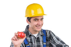 A worker with an apple smiles Royalty Free Stock Photo