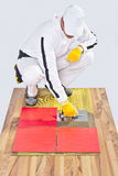 Worker applies ceramic tiles Royalty Free Stock Photo