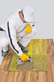 Worker applies tile adhesive Royalty Free Stock Photos