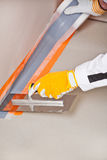 Worker apply hydro insulation tape. Around the wall and floor Stock Images