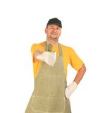 Worker in apron with thumbs up. Royalty Free Stock Photography