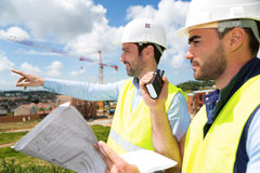 Worker and architect watching some details on a construction Royalty Free Stock Images