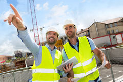 Worker and architect watching some details on a construction Stock Photo