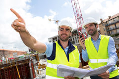 Worker and architect watching some details on a construction Royalty Free Stock Photography