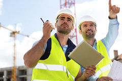 Worker and architect watching some details on a construction Royalty Free Stock Photos