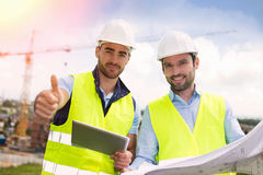 Worker and architect watching some details on a construction Royalty Free Stock Image