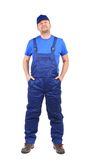 Worker with arms in pockets. Royalty Free Stock Images