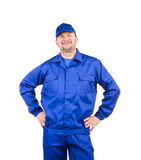 Worker with arms on waist. Royalty Free Stock Images