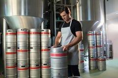 Worker arranging kegs Royalty Free Stock Photos