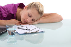 Worker asleep at desk Stock Image